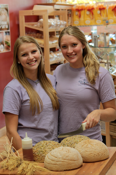 Great Harvest Clackamas Team Members slice Whole Grain Bread